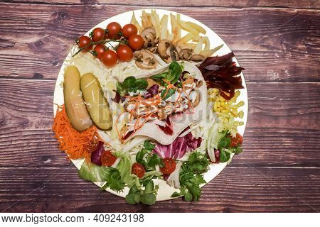 Plate Of Chicken Fajitas With Vegetables, Cherry Tomatoes, Pickles, Corn, Salad, Carrots, Beets, Mus