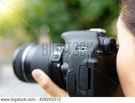 Photographer Takes Pictures With The Camera. The Woman Takes Pictures On The Camera.
