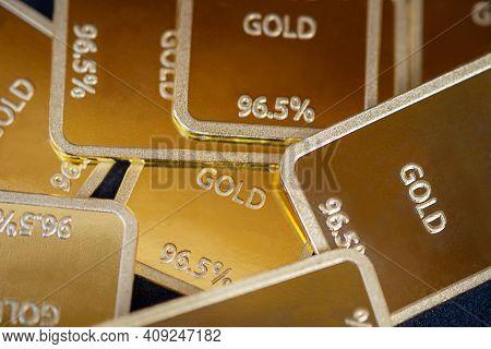 Gold Bars Background. Many Gold Ingots Are Close