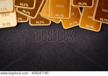 Gold Bars On A Black Background. Stability Concept. Gold Ingot Background