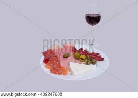 Starter Plate With York Ham, Spanish Serrano Ham, Mojama, Fresh Cheese And Olives With A Glass Of Re
