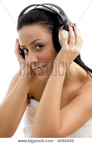Top View Of Smiling Female Wearing Headphone