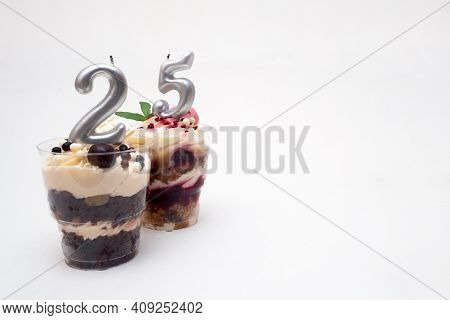 Birthday Trifle Cake With Candle Labeled Number 25 On White Background With Copy Space. Portioned Mi
