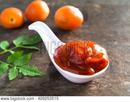 Ketchup On White Spoon With Wood Background. Is A Mixture Of Tomato Sauce Spaghetti Or Eaten With Fr