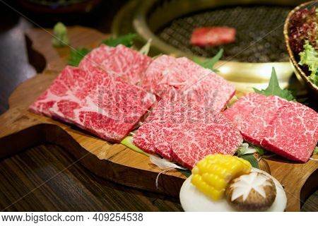 Selected Omakase Wagyu Mori Served On Wooden Plate. Tokujyo Rosu, Jyo Karubi, Omi Momo And Omi Ichib