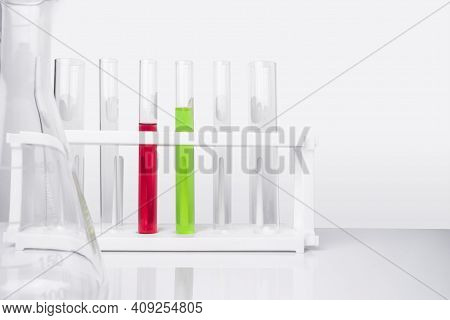 Water Quality Monitoring In Chemical Laboratories. The Red Chemical In The Test Tube Has A High Ph R