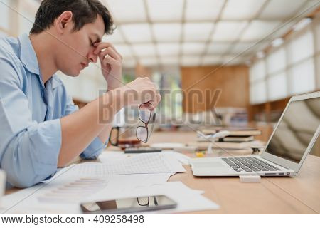Businessman Eyes Pain. Tired, Overworking And Taking Off Glasses Massaging Eyes After Long Time Work