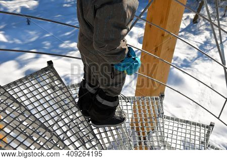 Metal Lattice Grate Is Used For The Outdoor Spiral Staircase. The Galvanized Grate Is Transparent, A