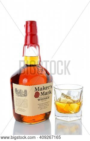IRVINE, CA - JANUARY 15, 2015: A bottle of Maker's Mark Whiskey and a glass. Maker's Mark was first bottled in 1958 and featured the brand's distinctive dipped red wax seal.