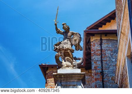 Sculpture Composition St. George And The Dragon On A Building In A Historical Part Of Upper Bergamo