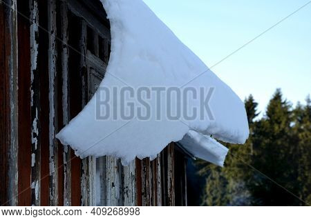 Galvanized Metal Roof In The Mountains With A Bar Against The Rapid Sliding Of Snow. If Snow And Ice