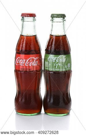 IRVINE, CA - FEBRUARY 15, 2015: Coca-Cola and Coca-Cola Life Bottles. Life is a reduced calorie soft drink sweetened with cane sugar and Stevia, containing 60% of the calories of Classic Coke.