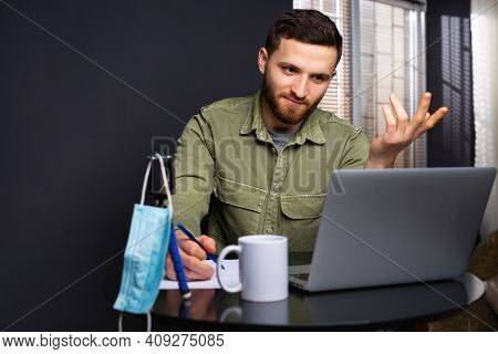 Photo Of A Perplexed Young Student Who Is Studying In Front Of A Laptop And Is Having Difficulties.