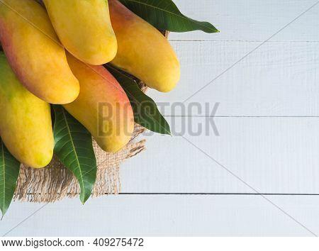 Mango  Mahachanok Or Rainbow Mango On Wood Background. Thai Food Concept.