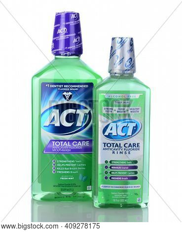 IRVINE, CA - January 05, 2014: Two bottles of ACT Total Care Anticavity Rinse. A 1 liter bottle and an 18 oz bottle of the oral hygiene mouthwash with fluoride.