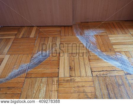 Scratched Parquet Flooring In The Room. Scratches, Chips And Dents On The Floor. Parquet In Need Of