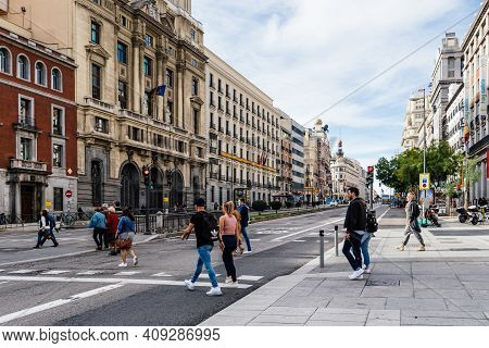 Madrid, Spain - November 1, 2019: People Crossing Alcala Street In Central Madrid. Sunny Day With Bl