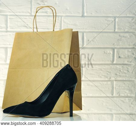 Black High-heeled Shoes. Womens Shoes With Heels. A Pair Of Womens Black Patent Leather Shoes On A W