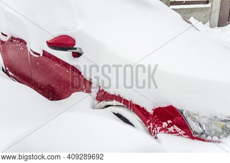 Snow Covered Parked Car In A Snowdrift