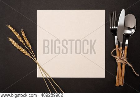 Top View Mockup Blank Recipe Paper Page With Mockup Text Space, Invitation Card And Cutlery On Black