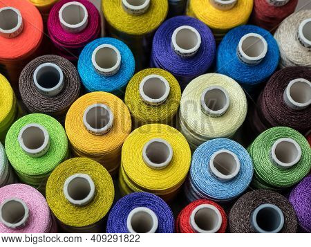 Multicolored Threads, Rows Of Spools For Sewing Machine And Embroidery