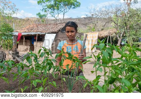 Rivas, Nicaragua. 07-15-2016. Portrait Of A Girl At Her Home In A Rural Area Of Nicaragua. They Have