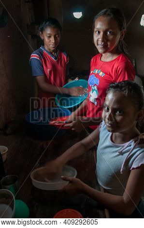 Rivas, Nicaragua. 07-15-2016. Girls Washing Dishes After Lunch In An Rural Area Of Nicaragua. Famili