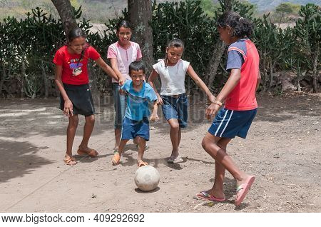 Rivas, Nicaragua. 07-15-2016. Children Playing Football In An Rural Area Of Nicaragua. Families Rely