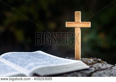 The Cross Is Placed Near The Bible. Natural Background It Is A Request For Blessing From God, The Po