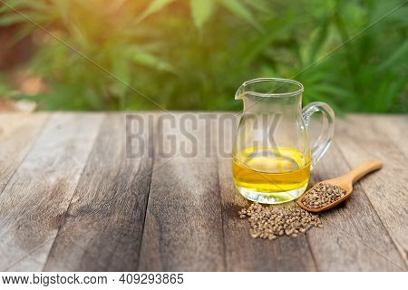 Cbd Hemp Oil In Glass Jars And Cannabis Seeds Cannabis Oil Concept By Researchers Or Medical Team Us