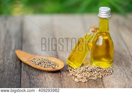 Cbd Hemp Oil In Glass Bottles And Cannabis Seeds Cannabis Oil Concept By Researchers Or Medical Team