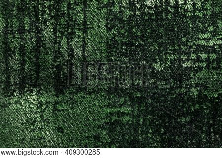 Dark Green And Olive Fluffy Background Of Soft, Fleecy Fabric. Texture Of Emerald Velveteen Textile