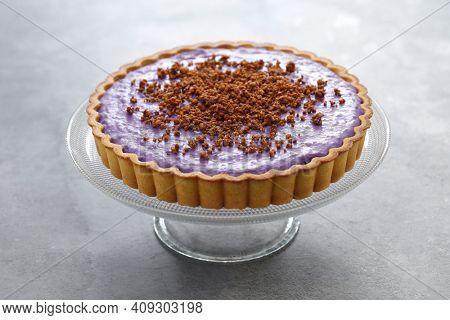 homemade ube pie topped with latik, Filipino dessert