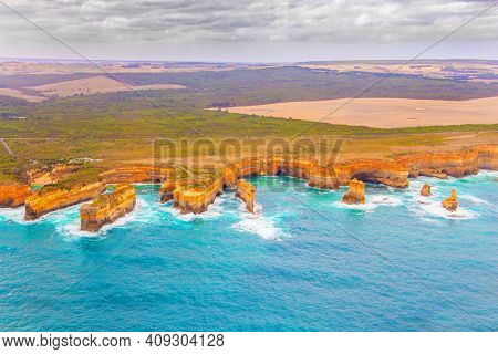 Aerial view. The Twelve Apostles are a group of limestone rocks in the Pacific Ocean near the coast. Great Ocean Road. Helicopter flight over the scenic Pacific coastline. Australia.