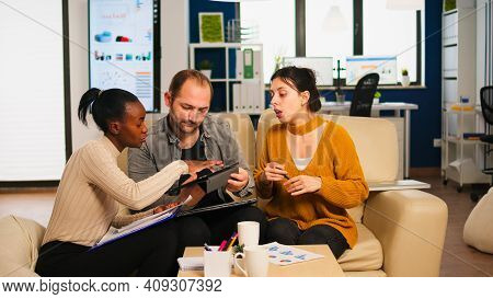 Diverse Businesspeople Analysing Financial Project During Corporate Meeting. Multiethnic Employees G