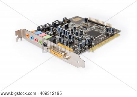Old Used Internal Sound Card For Pci Bus Used In Desktop Computers On A White Background, Close-up I