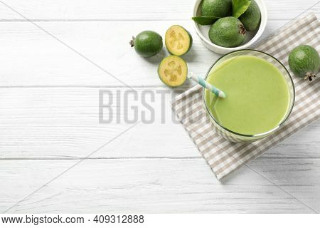 Fresh Feijoa Smoothie And Fresh Fruits On White Wooden Table, Flat Lay. Space For Text