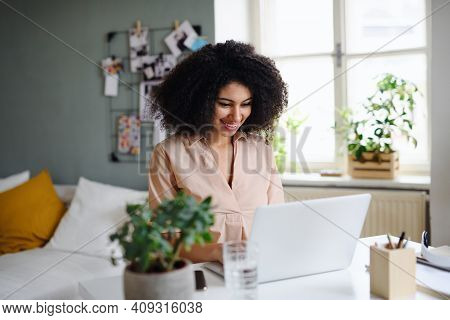 Happy Young Woman With Laptop Working Indoors At Home, Home Office Concept.