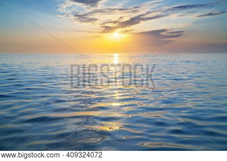 Sun and golden sea sunset surface background. Abstract light way to the sun. Nature composition.