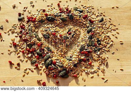 Food Background Of Mix Of , Condiments And Seeds Close Up With Selective Focus In Shape Of Heart On