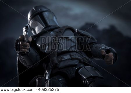 FEB 20 2021: Star Wars The Mandalorian Din Djarin standing over his quarry - bring you in warm or bring you in cold - Hasbro action figure