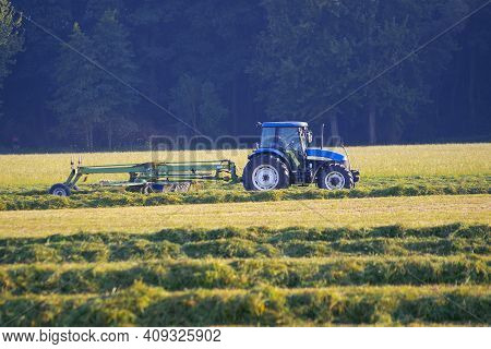 Mechanization Of Agriculture. Modern Agricultural Equipment Is Used To Harvest Hay.