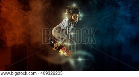 Skateboarder doing a jumping trick. Freestyle extreme sports concept