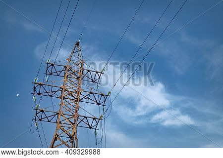High Voltage Towers With Sky Background. High Voltage Electric Pole With Cloudy Sky. Electric Pole O