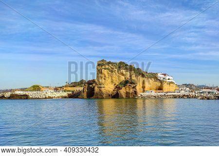 Yellow Tuff Rocks On The North Coast Of Naples, Torregaveta, Pozzuoli, Italy.