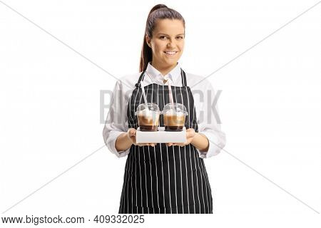 Young female waitress holding two cups of takeaway coffee isolated on white background