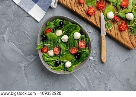 Fresh Salad With Mozzarella Cheese, Tomato And Spinach. Healthy Dieting Food, Top View.