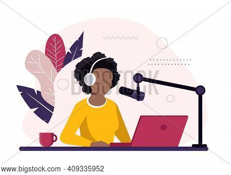 African-american Radio Host Sitting In Front Of Microphone. Young Woman In Headset Working At The Ra