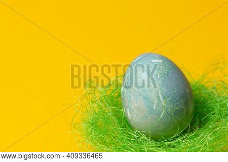 Colored Easter Eggs In A Straw Nest