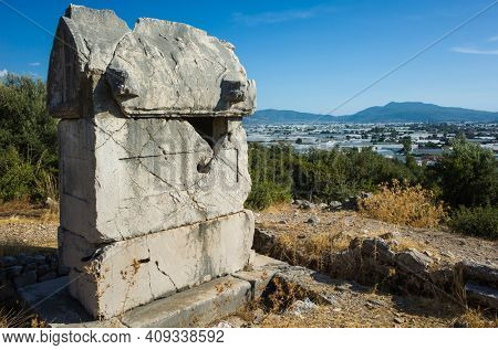 Rock tomb ruin at necropolis of Xanthos Ancient Lycia City, Turkey. Old Lycian civilization heritage architecture